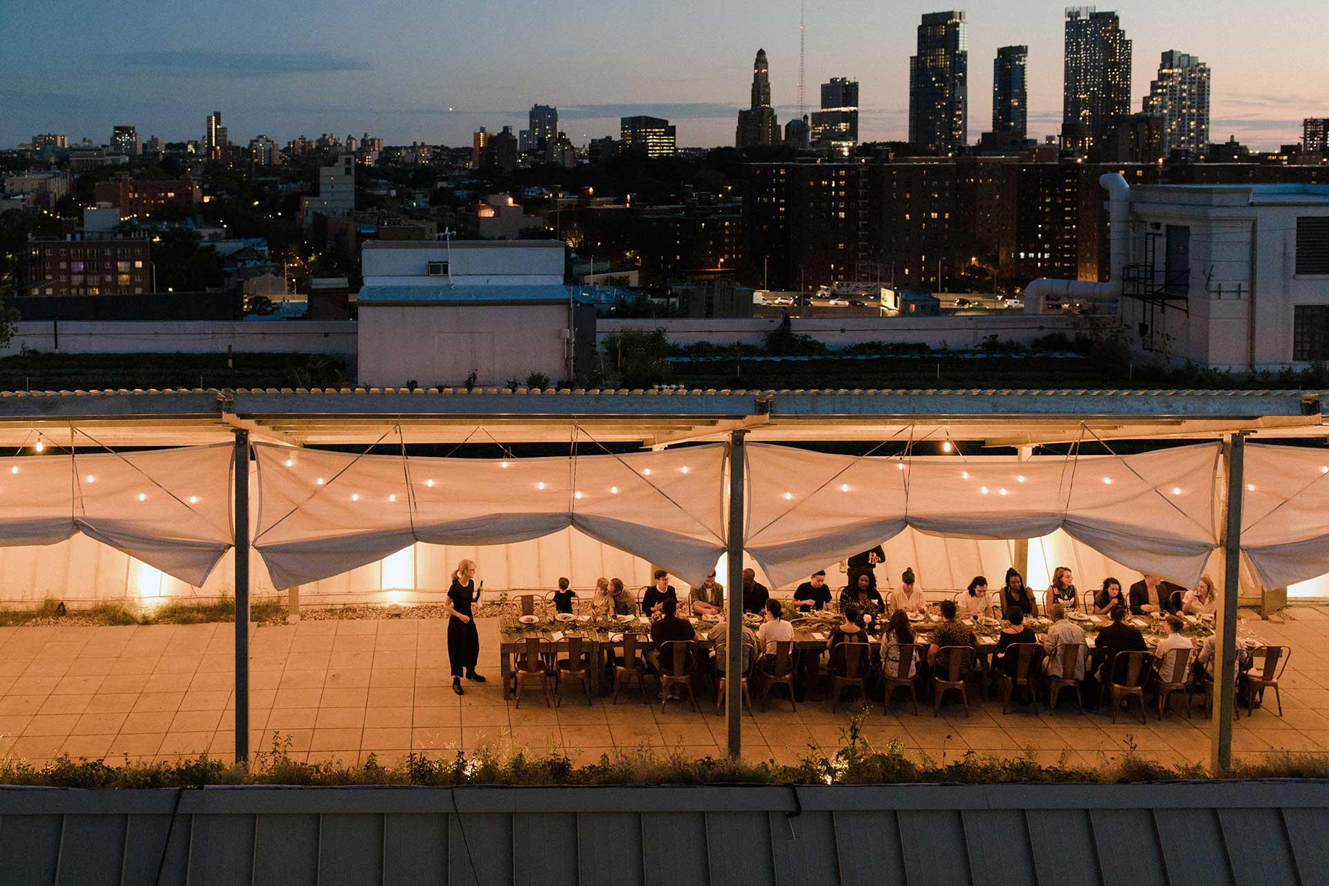 The dinner tent with the city skyline behind.