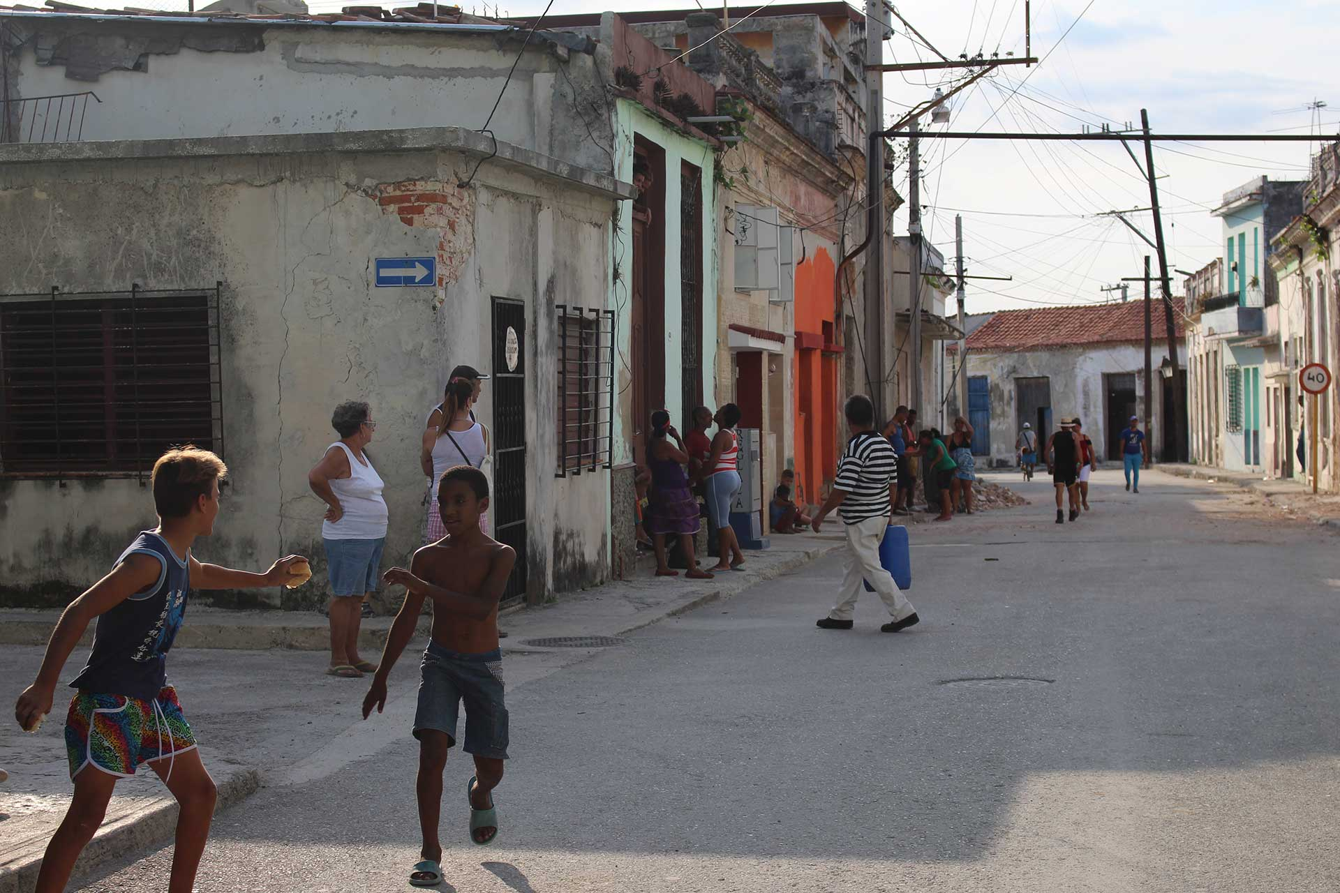 Kids playing on a quiet Cuban street.