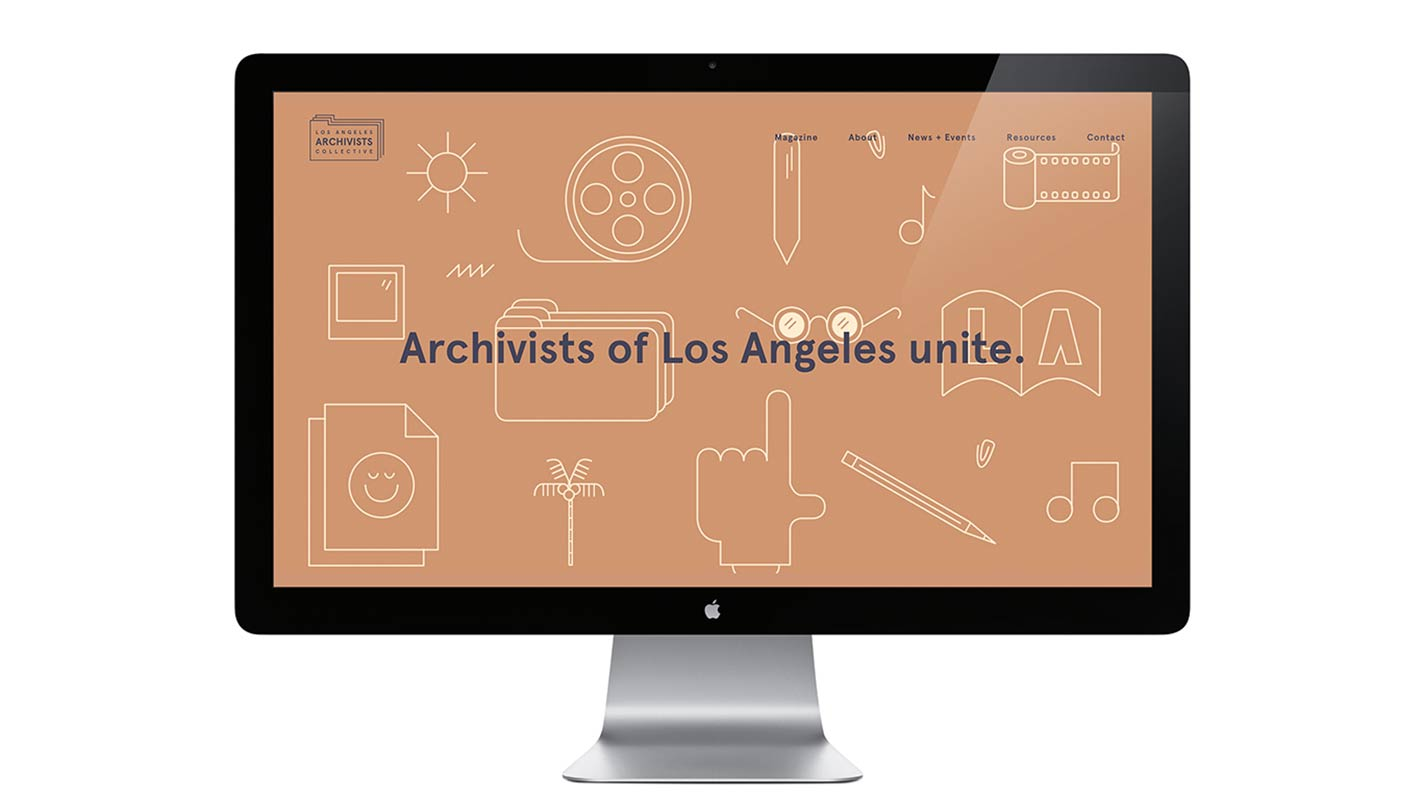 "A desktop computer with a website open that reads, ""Archivists of Los Angeles unite."""