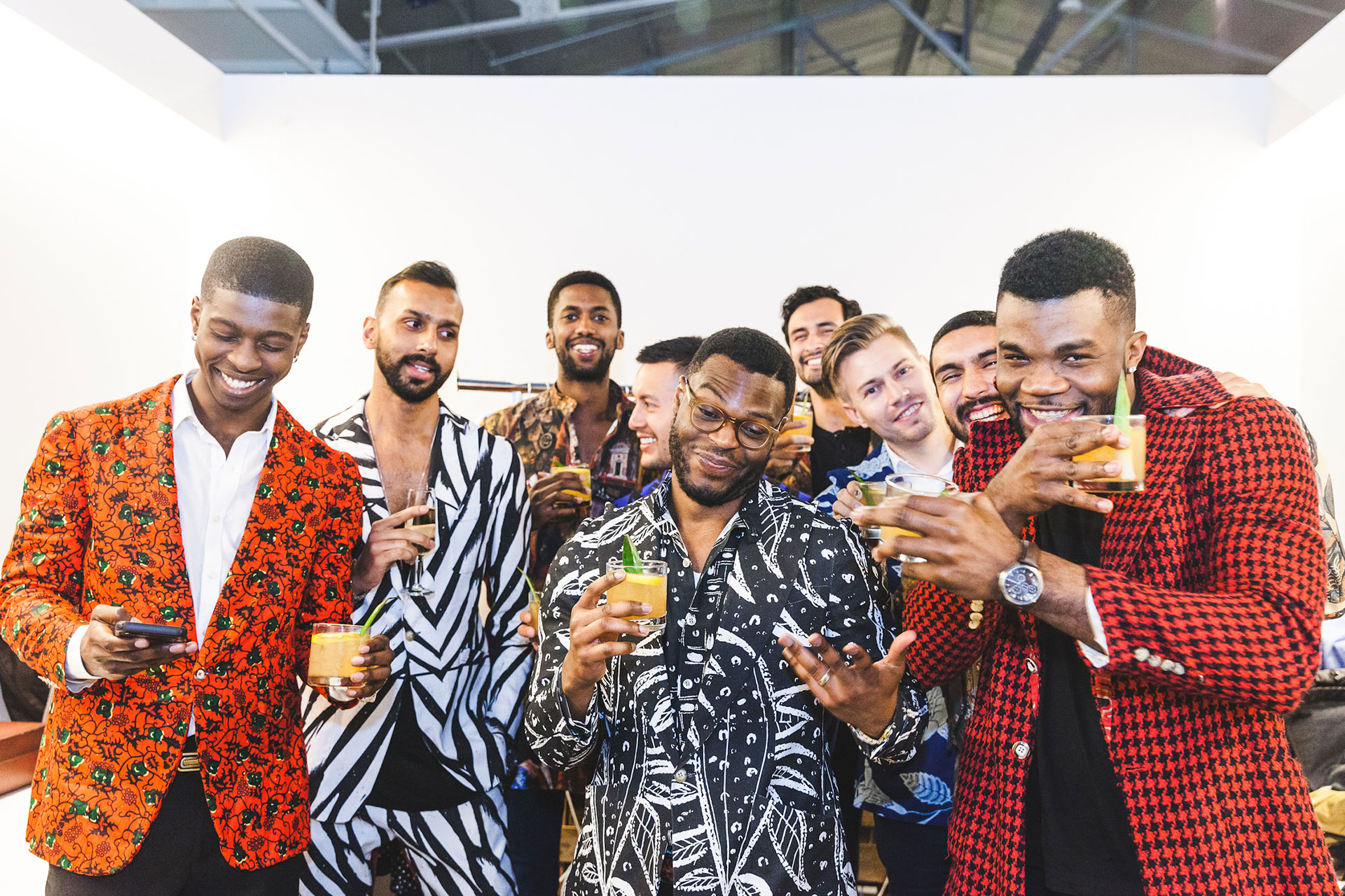 Walé Oyéjidé and a group of young men, gathered together with cocktails.