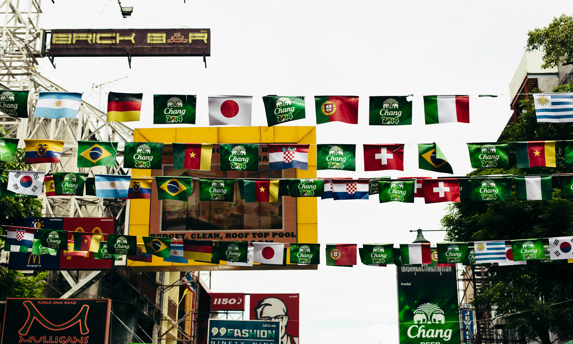 Flags hang above the street