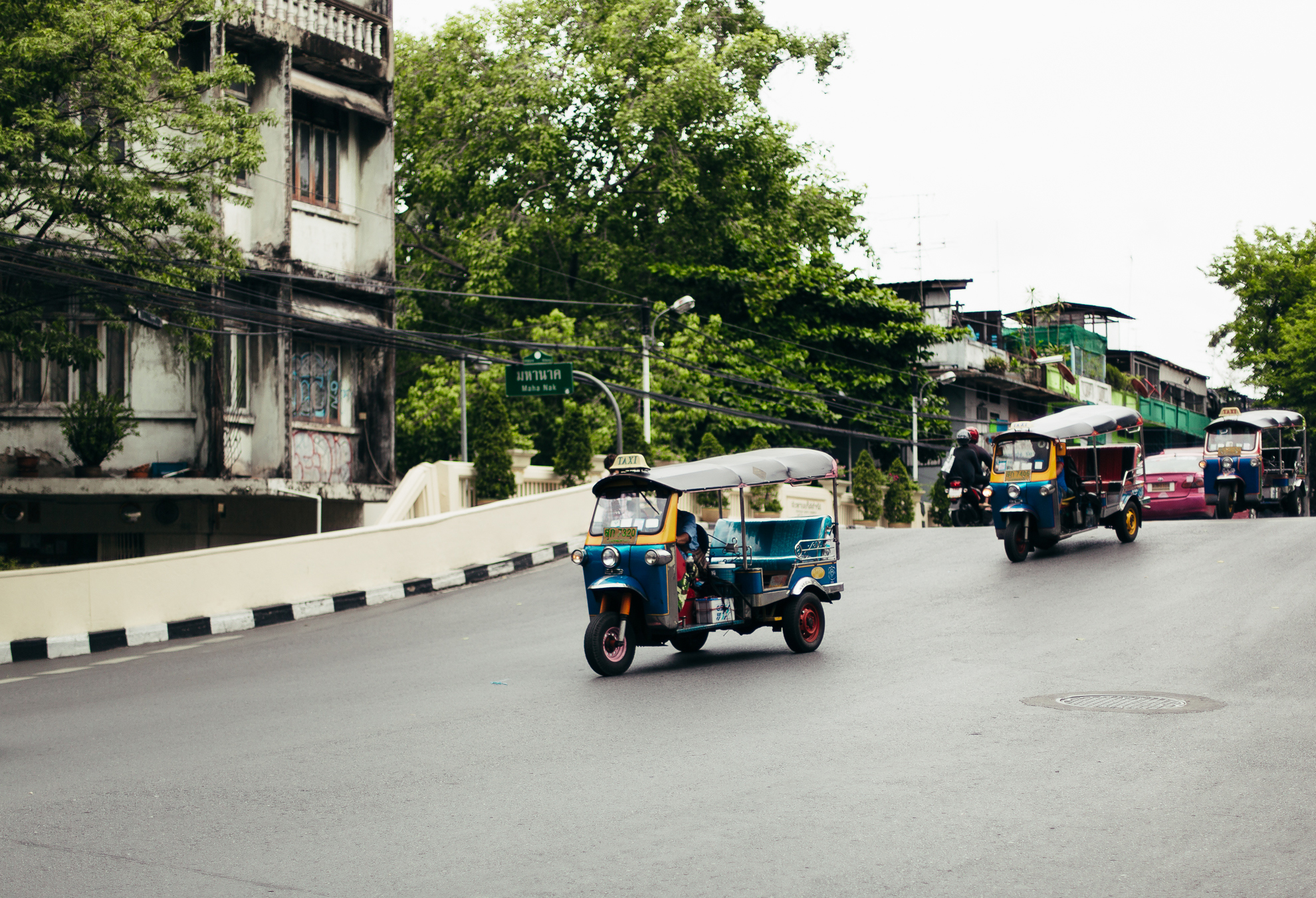 Taxis ride down the street
