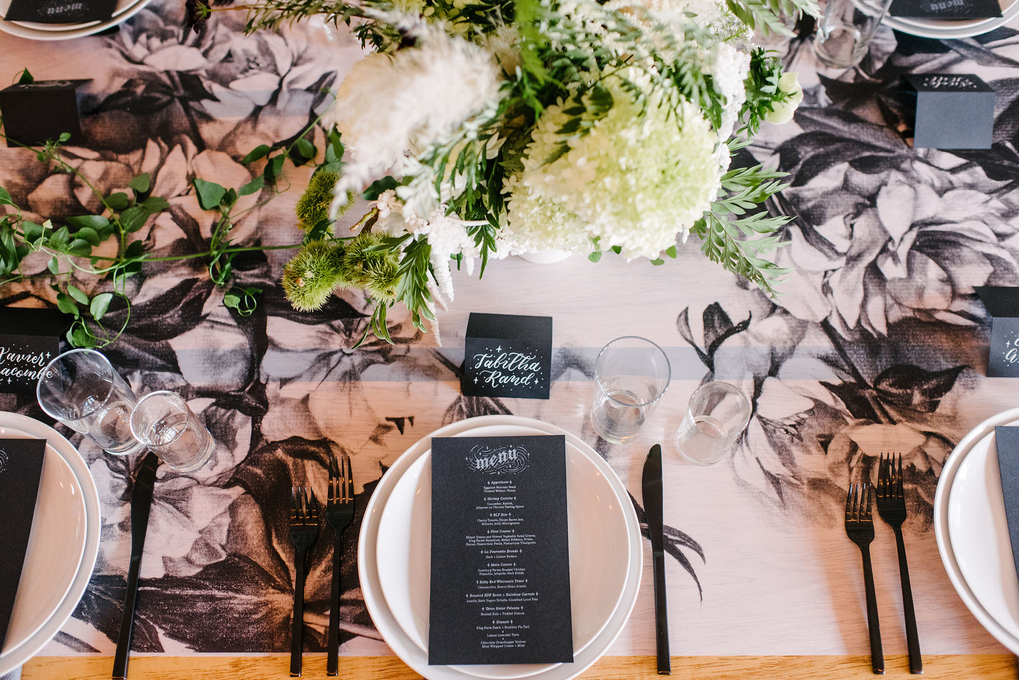 a place setting with flowers