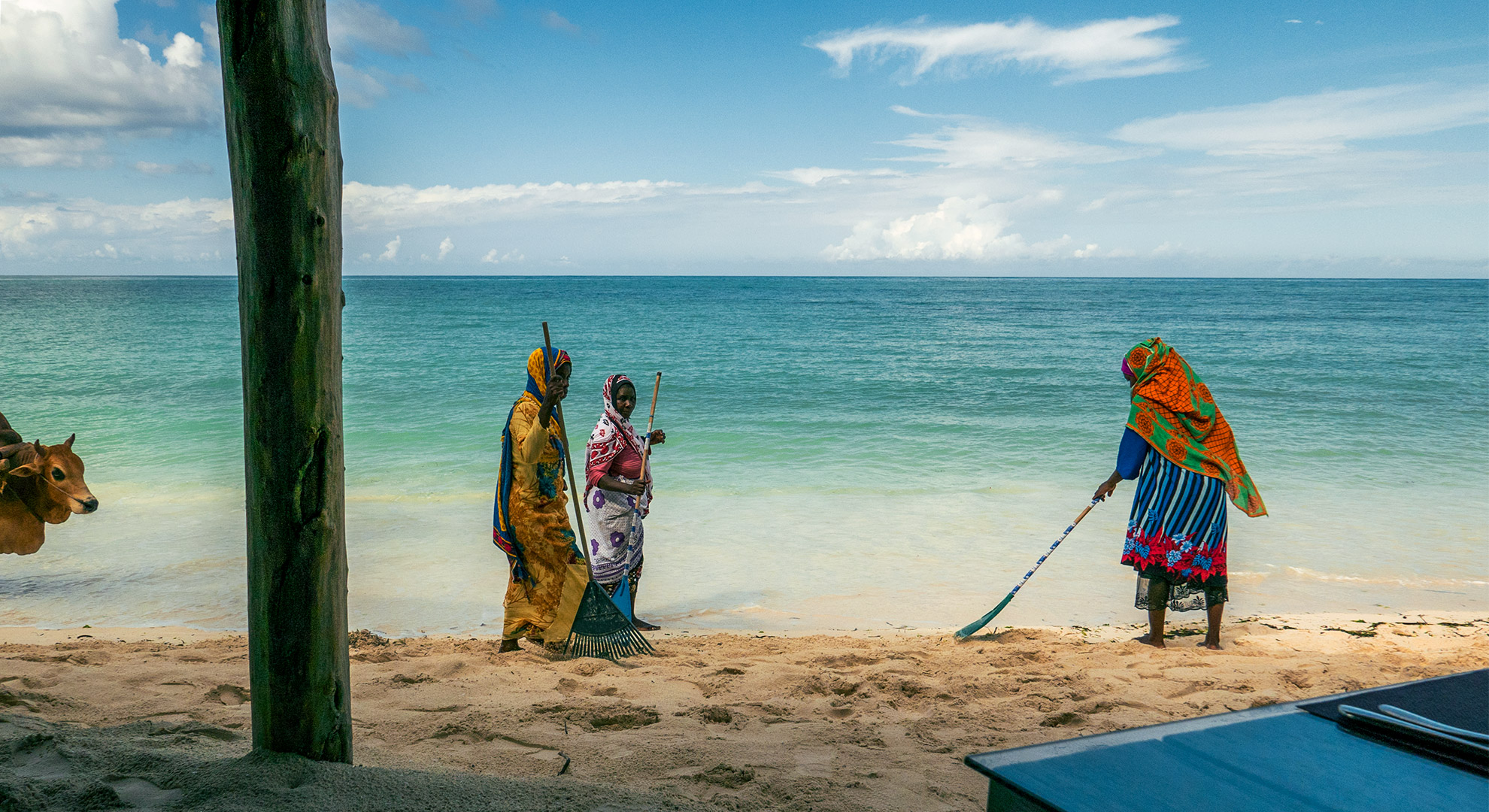 Women in traditional wraps on a beach