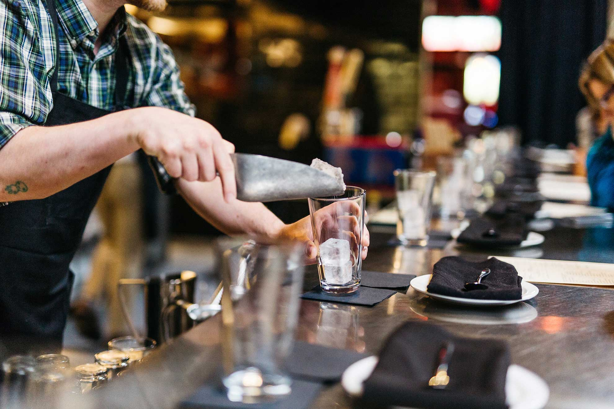 A bartender pours beverages