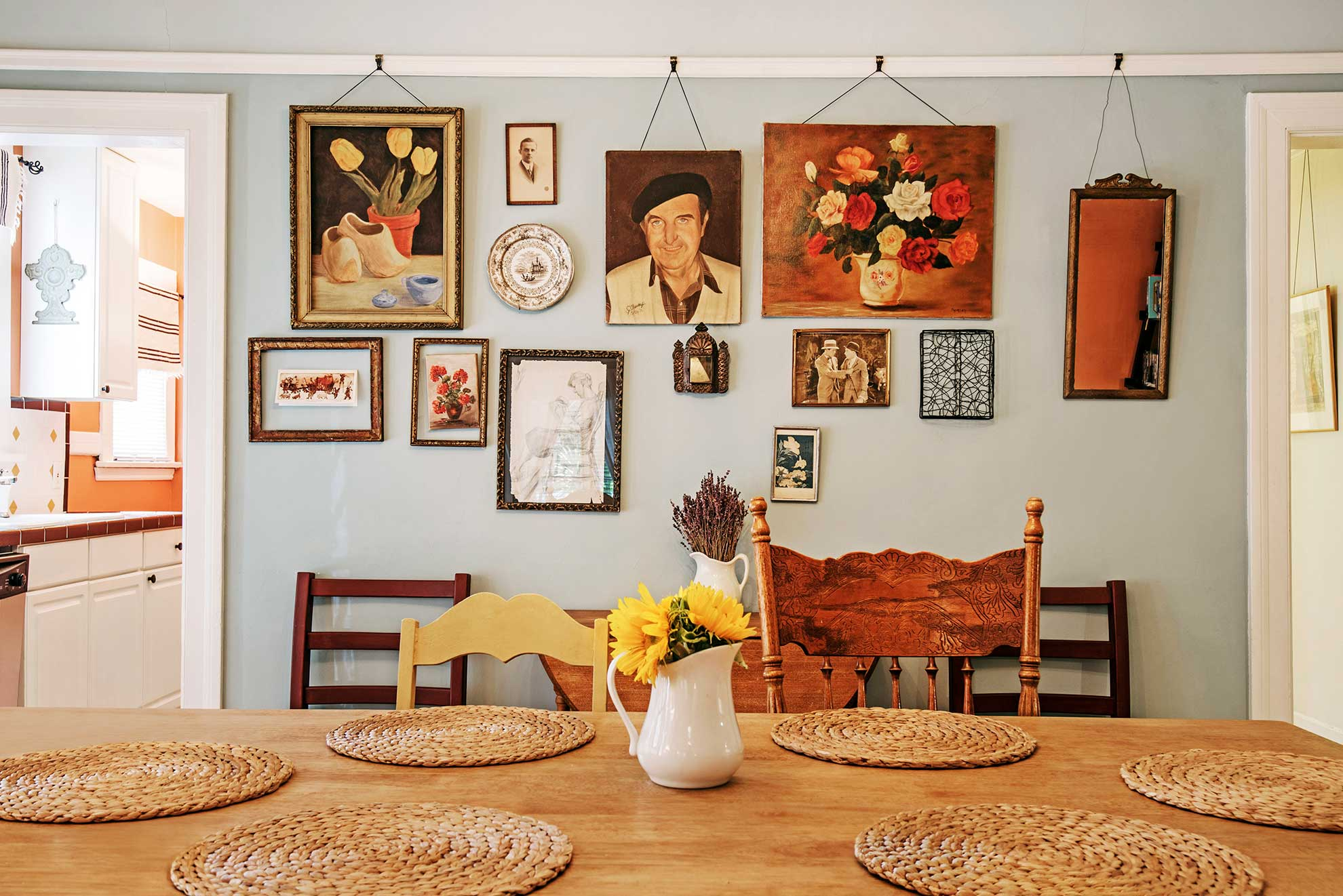 Airbnb listing interior of dining table and art hanging on the wall